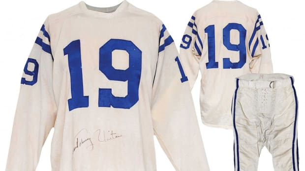 Circa-1960 Johnny Unitas Baltimore Colts game-used and autographed home uniform. Sold for $118,230; record price for any professional football player's jersey at auction. Grey Flannel Auctions image