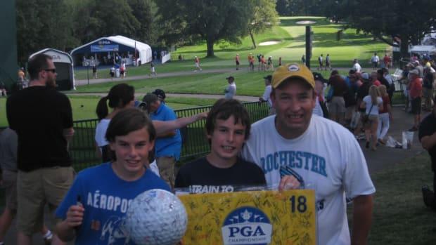 One day, three kids, one adult and more than 200 autographs. The PGA Championship practice round proved to be an autograph bonanza. Pictured are Devon, Dalton and the author. All photos courtesy of Tom Talbot.