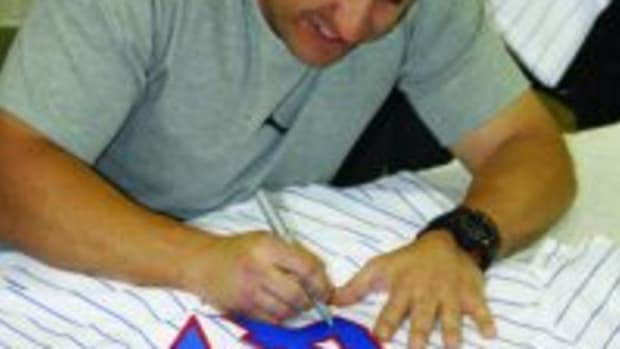Chicago Cubs catcher Miguel Montero autographs a jersey at the annual Fanatics Authentic Sports Spectacular. Photos courtesy Ross Forman