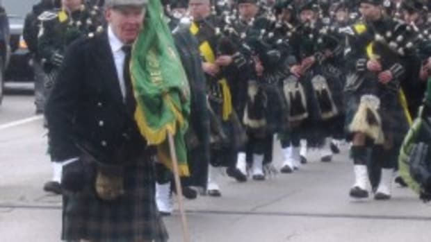 "Future prospect Johnny Lattner (only 80) won the Maxwell Award in both 1952 and 1953, won the Heisman in 1953 and played on most of the subsequent ""Old Timers"" Notre Dame teams. He usually leads off the St. Patrick's Day Parade in Chicago, shown here in 2013."
