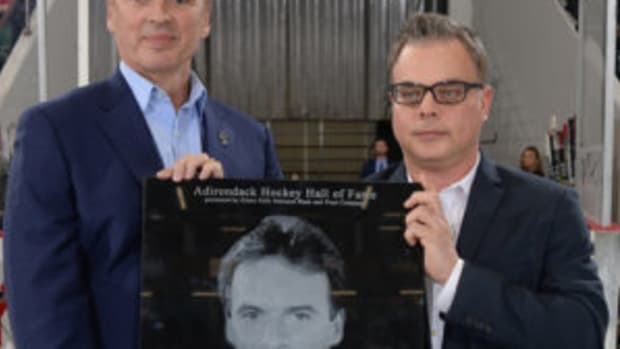 Neil Smith (left) with his Hall of Fame plaque with Adirondack Thunder General Manager Jeff Meade (right) at the induction ceremony when Smith was inducted into the Adirondack Hockey Hall of Fame. (Photos courtesy Adirondack Thunder organization)