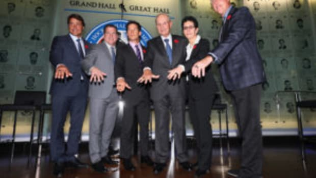 (L-R) Teemu Selanne, Mark Recchi, Paul Kariya,Jeremy Jacobs, Danielle Goyette and Dave Andreychuk take part in a media opportunity at the Hockey Hall Of Fame and Museum on November 10, in Toronto, Canada. (Photo by Bruce Bennett/Getty Images)