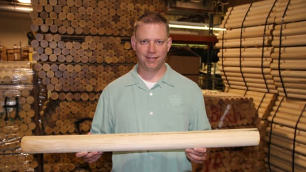 PJ Shelley, tour and programming director at the Louisville Slugger Museum & Factory, holds a bat in its infancy. Shelley said Louisville Slugger only uses trees from Pennsylvania and New York. All photos by Ross Forman.