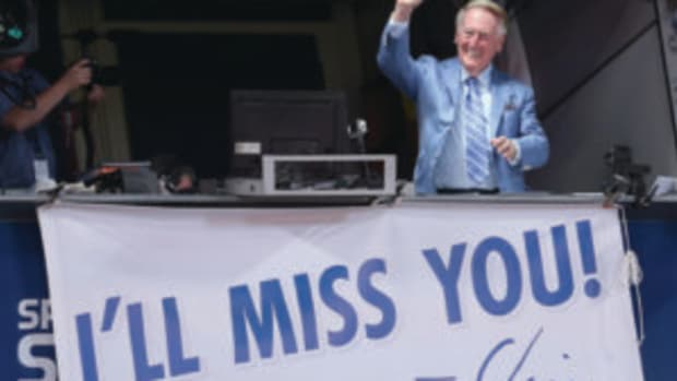 Los Angeles Dodgers broadcaster Vin Scully waves to the crowd after leading in the singing of Take Me Out to the Ball Game during the seventh inning stretch of the game with the Colorado Rockies at Dodger Stadium on September 24, 2016 in Los Angeles, California. The Dodgets won 14-1. (Photo by Stephen Dunn/Getty Images)