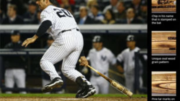 A photo-matched bat example includes this shot of Yankees catcher Jorge Posada hitting a pinch-hit RBI single in Game 2 of the 2009 World Series. (Images courtesy PSA)