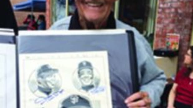 Joe Sinnott with one of his favorite drawings he drew featuring Willie Mays, Willie McCovey and Juan Marichal. The drawing is autographed by all three Hall of Famers.