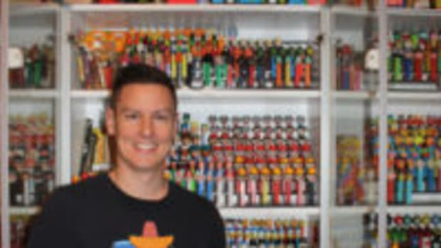 Brian Jaskolski stands in front of just a portion of his collection of Pez dispensers. (Photos courtesy Brian Jaskolski)