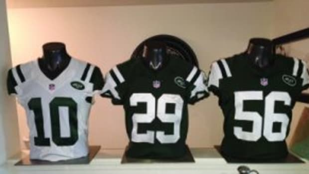 New York Jets game used jersey display in Polaniecki's living room. (Photo by Andrew Polaniecki)