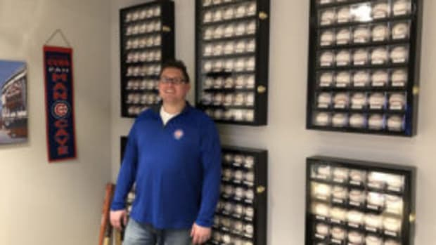 Beau Thompson amongst the many autographed baseballs he has added to his sports memorabilia collection through the years. (Photos courtesy Beau Thompson)