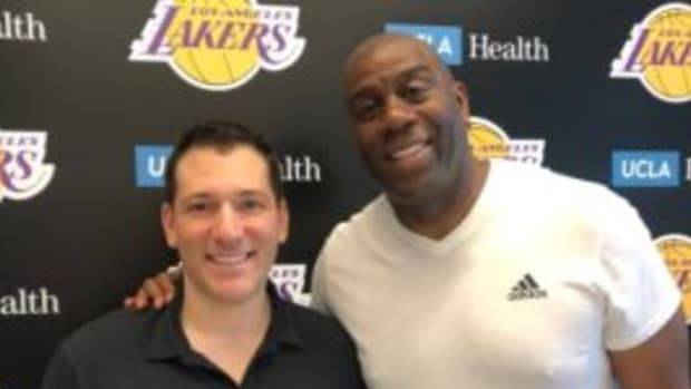 Press Pass Collectibles President Kyle Bell (left) with Magic Johnson (right). (Photo courtesy Press Pass Collectibles)