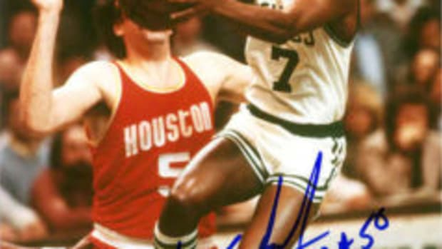 """A Nate Archibald autograph that includes the inscriptions """"HOF 1991"""" and """"NBA 50."""""""