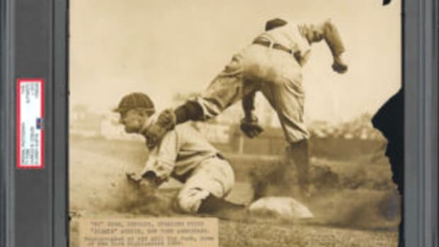 The record-setting, PSA-certified circa 1910 Type 1 photo shows Detroit Tigers Hall of Famer Ty Cobb stealing third base in a game against the New York Highlanders. (Image courtesy PSA)