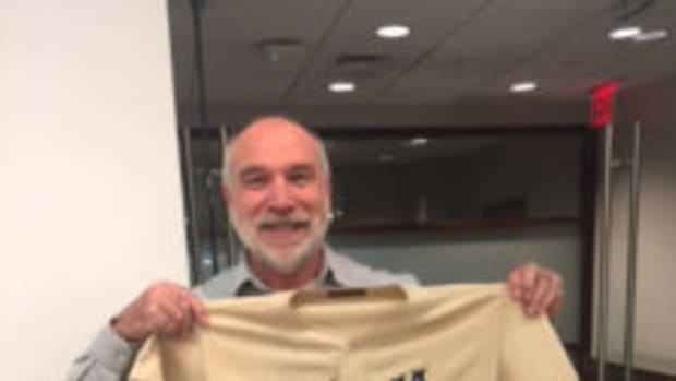 SCD columnist David Moriah holds up the game-used 1947 Jackie Robinson jersey that was available in a November auction hosted by Heritage Auctions. It sold for $2.05 million. (Photo courtesy David Moriah)