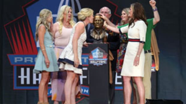 The family of the late Pat Bowlen surround Bowlen's HOF bust during his enshrinement ceremony. Photo by Frank Jansky/Getty Images