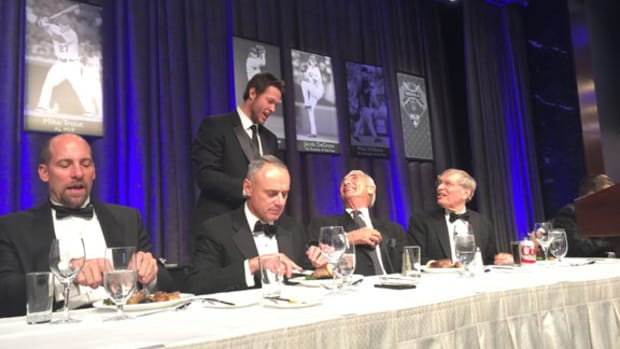On the dais at the awards dinner of the New York chapter of the BBWAA were, from left, John Smoltz, incoming commissioner Rob Manfred, Clayton Kershaw (receiving a signed ball from Koufax), Sandy Koufax and outgoing commissioner Bud Selig. David Moriah photos.