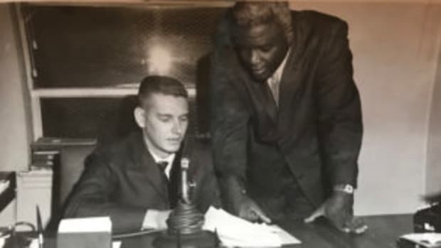 Gar Miller with Jackie Robinson, when he was vice president of human resources for Chock Full of Nuts in New York, circa 1964. (Kenny Chu photo)