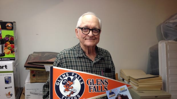 Frank Schafer, a former co-owner of the Glens Falls Tigers with Richard Stanley, displays a rare Tigers pennant. Schafer recalls crafting a team and a place to play in Glens Falls as close to a miracle.