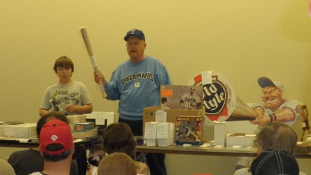 "Dick ""The Polish Eagle"" Jonckowski, auctions a Twins mini bat at a recent Twin Cities Sports Collectors Club auction."