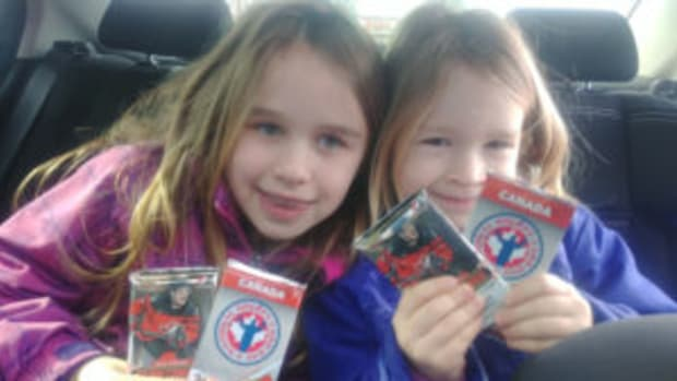 Members of the Poray family enjoy the spoils of National Hockey Card Day held February 23. (Photo courtesy Tom Poray)