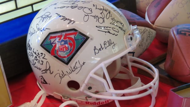 One of the lots in the Nancy Irsay Estate Auction was a helmet commemorating the 75th Anniversary of the NFL. The helmet contained autographs of several members of the 75th Anniversary Team. Photos by Joe Dynlacht.
