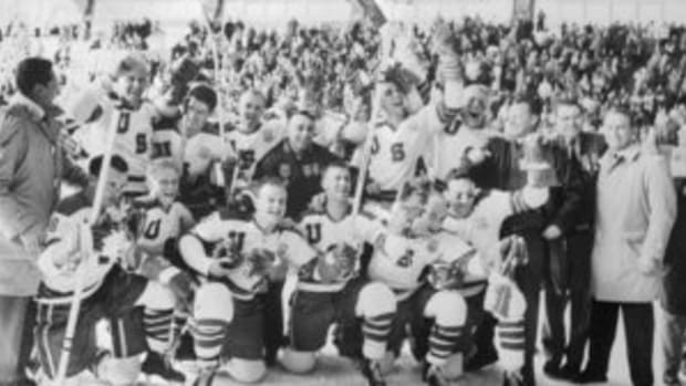 A jubilant U.S. hockey team poses for a photo after defeating Czechoslovakia 9-4 to give the United States its first gold medal on the ice in the Olympics. (Photo courtesy Getty Images - Bettmann / Contributor)