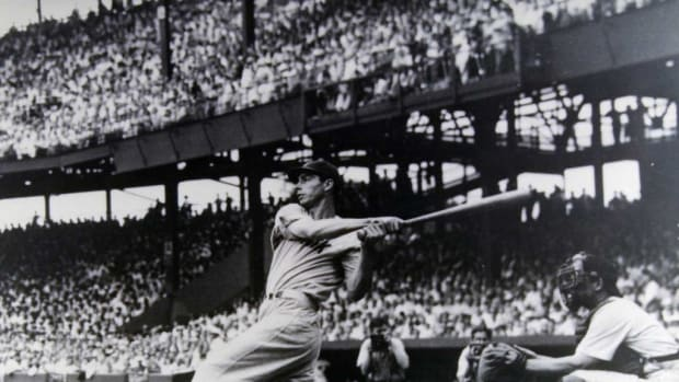 A classic shot of the great Joe DiMaggio in action. The only thing that's wrong is the signature is a fake.