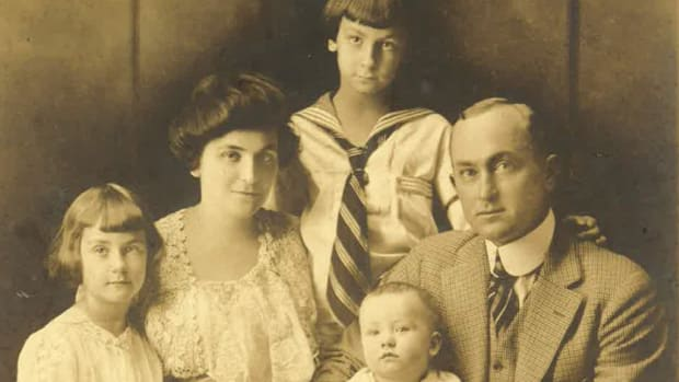 In this family photo, reportedly taken in 1918, Ty and his wife Charlie are shown. Ty holds son Herschel; at left is daughter Shirley, born in 1911, and in back is son Ty, born in 1910.
