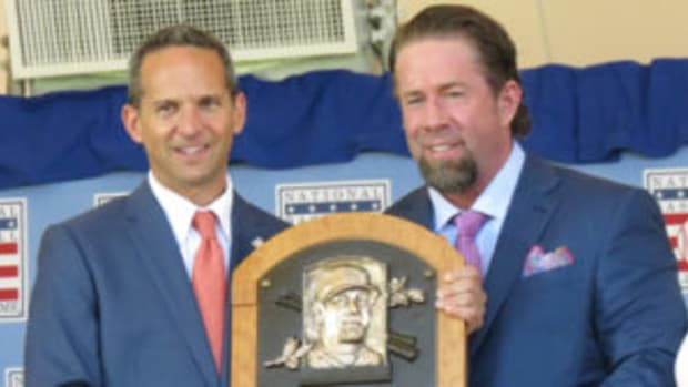 Jeff Bagwell (right) receives his Hall of Fame plaque after being inducted into the Baseball Hall of Fame. (David Moriah photos)
