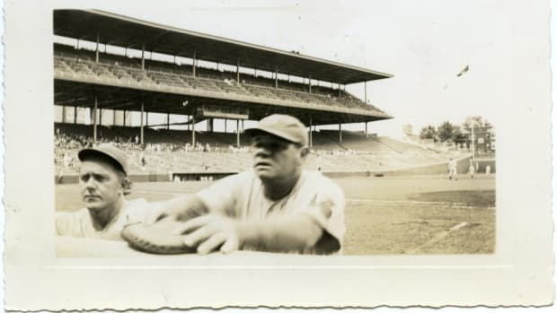 Can anyone help ID some details from this photo of the Babe - the stadium, other player, etc.?