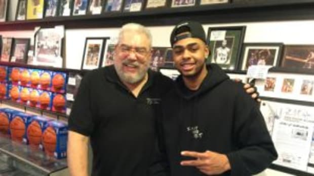 T.J. Schwartz (left) and Los Angeles Lakers point guard D' Angelo Russell (right). Schwartz hosted a autograph session for Russell at his store. (Photo courtesy T.J. Schwartz)