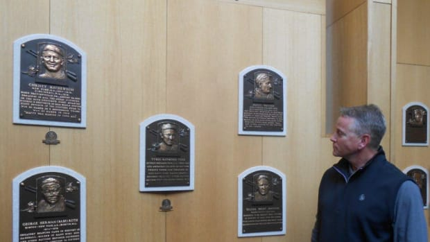 Tom Glavine admires plaques of the first five players inducted to the Baseball Hall of Fame, during a spring tour of the the shrine. The five players, counterclockwise, from top left, are Christy Mathewson, Honus Wager, Walter Johnson, Ty Cobb (in center) and Babe Ruth. Cobb is in the middle because he had the highest vote total of all first-year members. Photos by Paul Post.