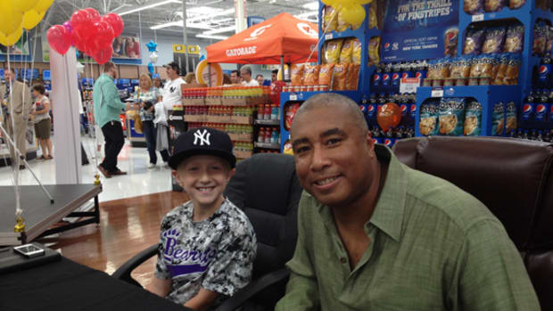 Bernie Williams, right, met with Nick Rychcik, left, in a program sponsored by PepsiCo at a Wal-Mart in conjunction with a Children's Miracle Network event. Rychcik is battling a form of childhood cancer. Paul Post photo.