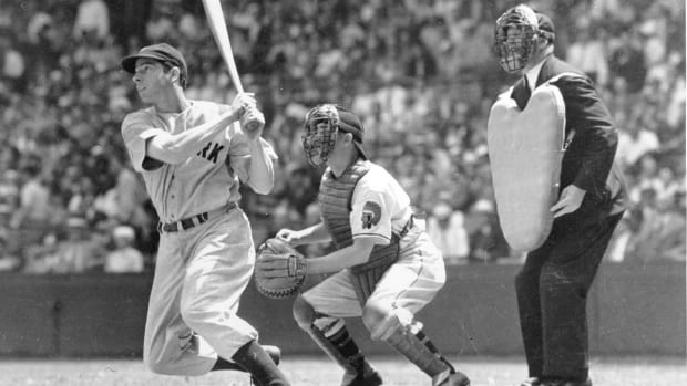 Joe DiMaggio takes a swing during his rookie season in 1936. Five years later, DiMaggio had a record 56-game hitting streak.