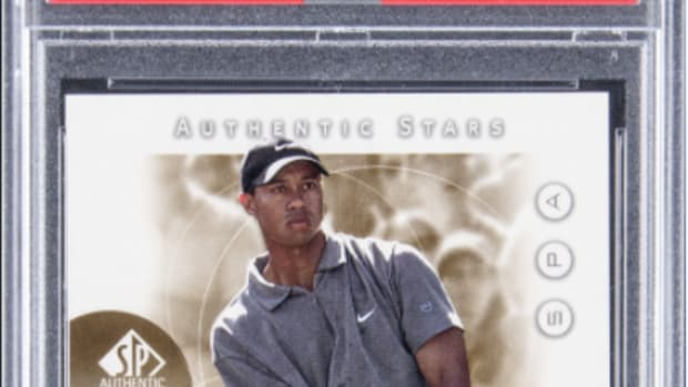 A Tiger Woods rookie card sold for $369,000, a record for a gold card.