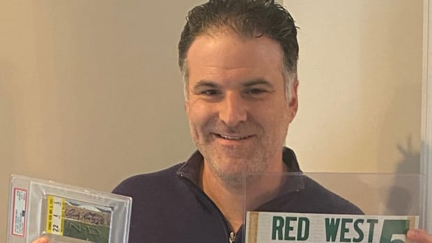 Darren Rovell shows off part of his eclectic collection of tickets and other sports memorabilia.