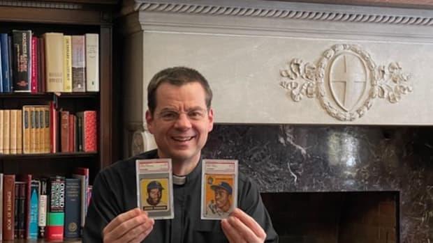 Father John Ubel and his baseball card collection.