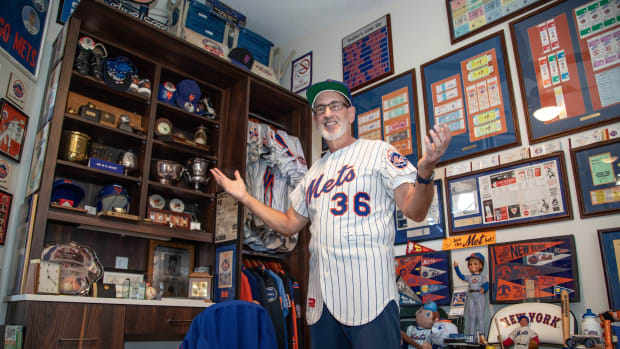 Andy Fogel shows off his New York Mets collection.