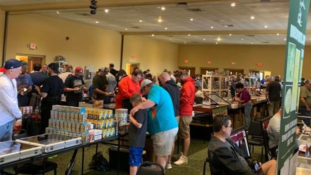 Collectors shop during the Scottsboro Card Show in Scottsboro, Ala.