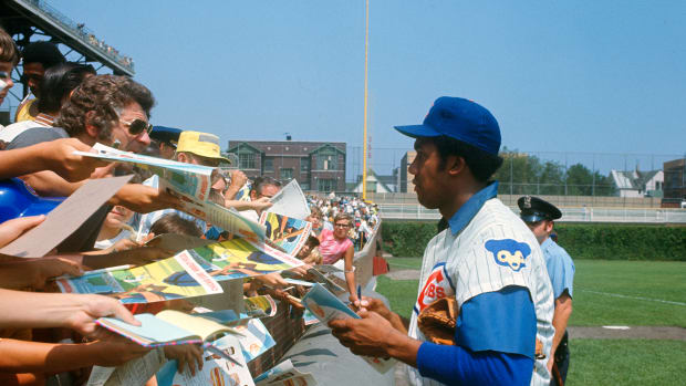 Fergie Jenkins signs autographs at Wrigley Field in Chicago in the 1980s.