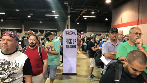 Collectors stand in a long line to submit cards to PSA at The National.