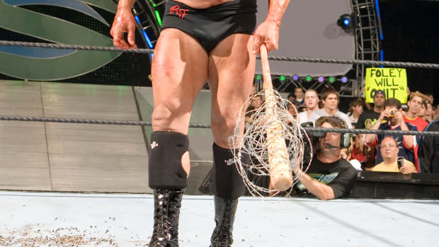 Ric Flair and his barb wire bat, which is being auctioned by Goldin Auctions.