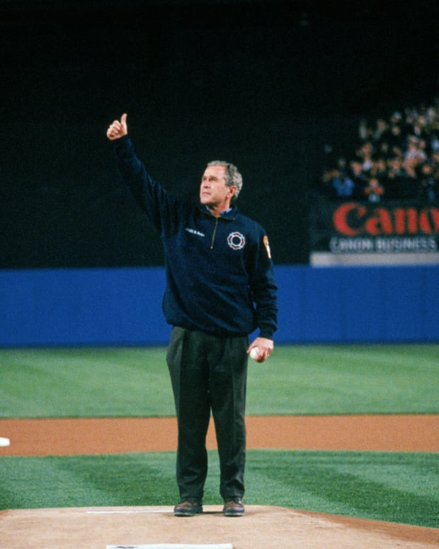 President George W. Bush gives a thumbs-up before throwing out the first pitch prior to Game 3 of the 2001 World Series at Yankee Stadium.