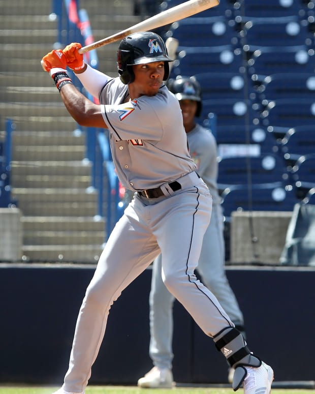 Rece Hinds, shown here in a Miami Marlins uniforms during a summer showcase, is one of the Reds' top prospects.