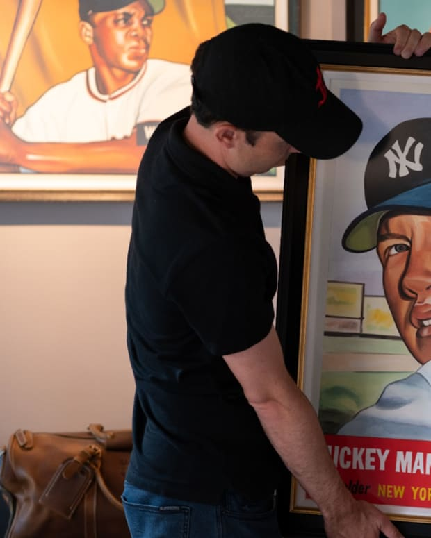 Artist James Fiorentino shows off his painting of a 1953 Mickey Mantle card.