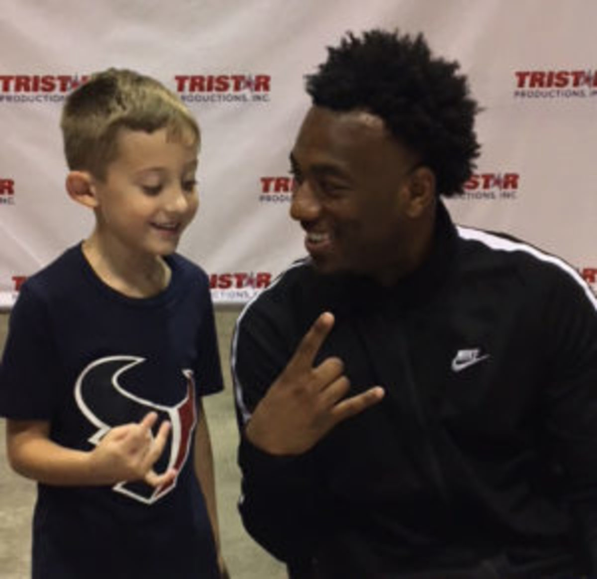 Keke Coutee (right) spends some time with a young fan. (Ross Forman)