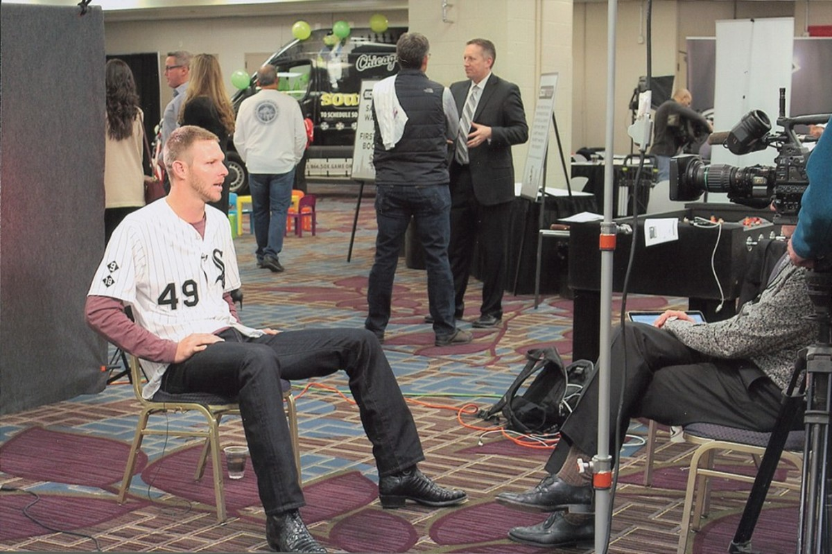 Sox ace Chris Sale conducting an interview.