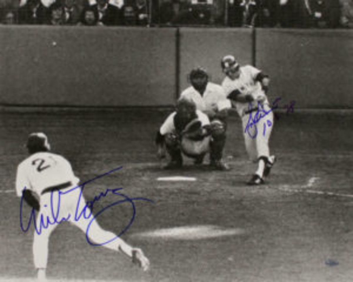 A photo of Bucky Dent's famous home run in 1978. The photo is autographed by Dent and Boston Red Sox pitcher Mike Torrez, who gave up the home run.