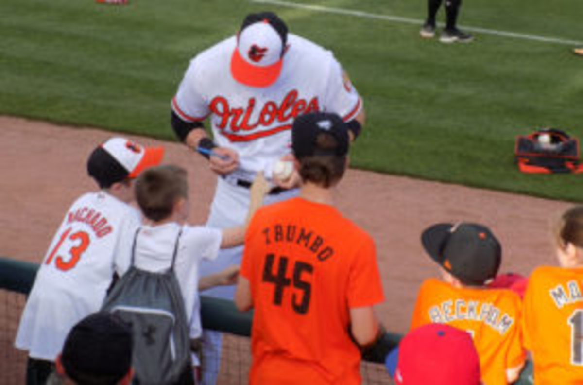 Young fans at Spring Training in Sarasota, Florida receive autographs from a Baltimore Orioles player.