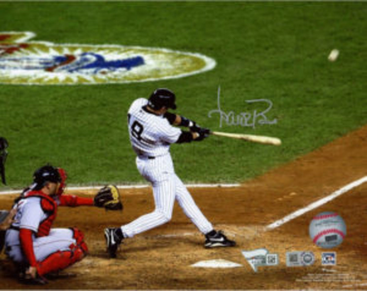 A signed photo of Aaron Boone hitting his historic walk-off home run that won the 2003 American League pennant.
