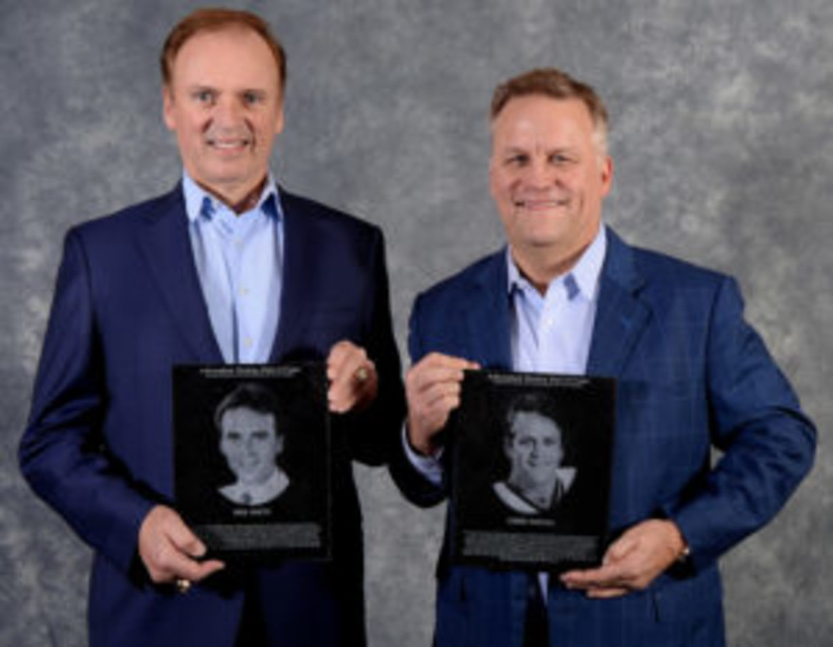 Neil Smith (left) is joined by former Adirondack Red Wing Chris Tancill (right), who was also inducted to the Adirondack Hockey Hall of Fame.